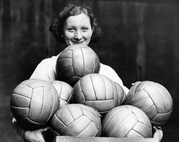 Ball Photograph - Woman Holding Box Of Footballs by Hulton Archive