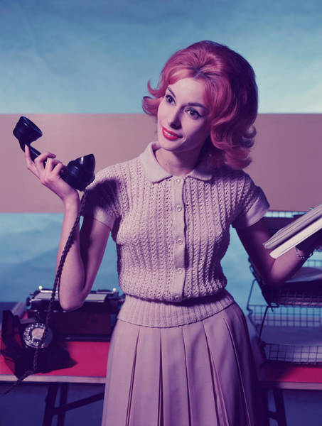 Telephone Photograph - Woman Holding Telephone Receiver by Hulton Archive