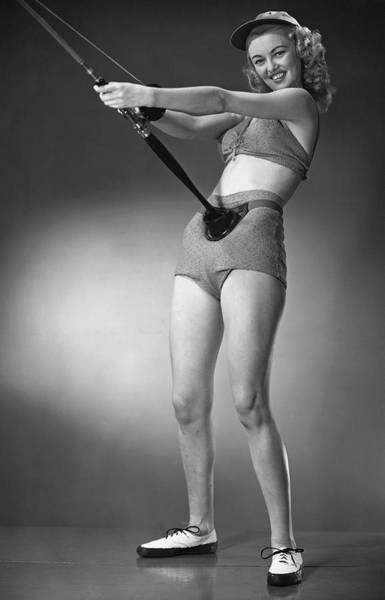 Sport Fishing Photograph - Woman In Beachwear Holding Fishing Rod by George Marks