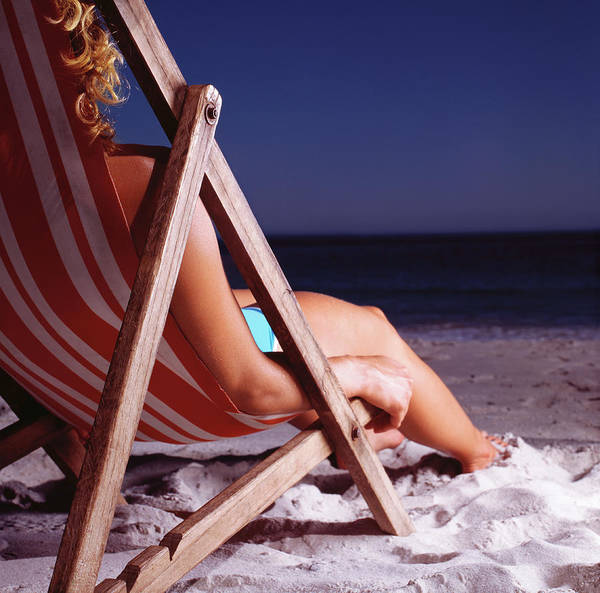 Deck Chair Photograph - Woman In Deck Chair On Beach, Close Up by Kelvin Murray
