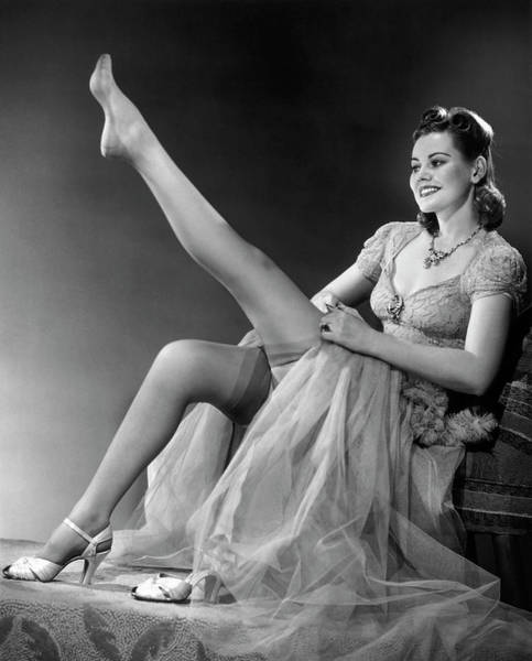 Garter Photograph - Woman In Evening Wear Pullin On Silk by George Marks