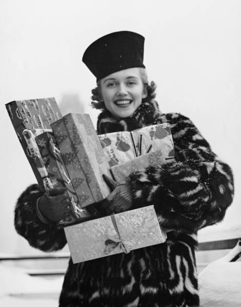 Wall Art - Photograph - Woman In Fur Coat Holding Christmas by George Marks
