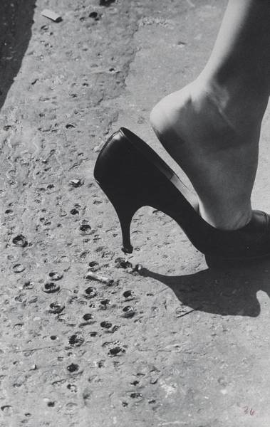 Shoe Photograph - Woman In Spiked Heeled Pumps Losing Shoe by James Burke