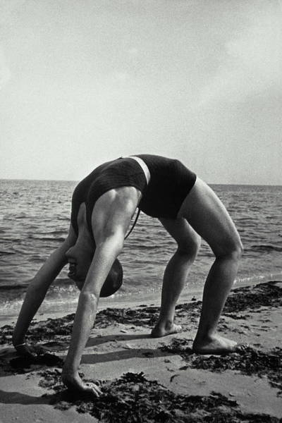 Bending Photograph - Woman In Wet Swimsuit Does A Backbend by Archive Holdings Inc.