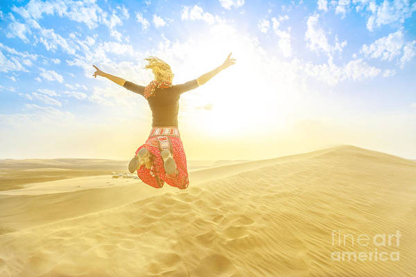 Photograph - Woman Jumping In Qatar Desert by Benny Marty