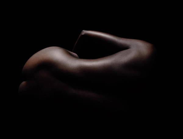 Buttocks Photograph - Woman Naked, Curled Against Black by Stuart Mcclymont