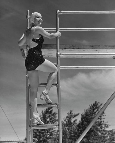 One Piece Swimsuit Photograph - Woman On Diving Board by George Marks