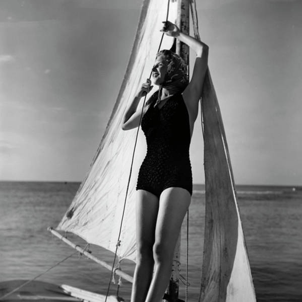 One Piece Swimsuit Photograph - Woman On Sailing Boat by George Marks