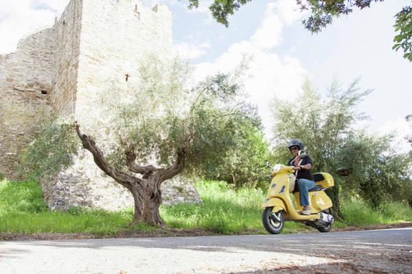 Crash Helmet Photograph - Woman On Scooter Riding Around Corner by Stefanie Grewel