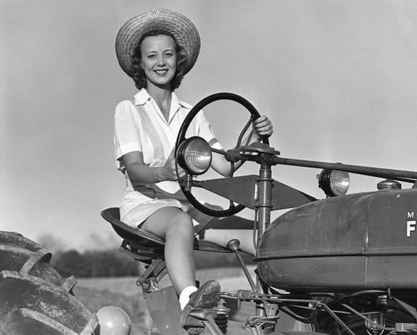 Farm Photograph - Woman On Tractor by George Marks