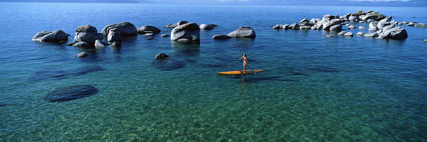 Wall Art - Photograph - Woman Paddle Boarding In A Lake, Lake by Panoramic Images