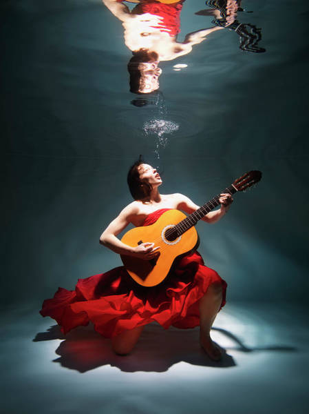 Underwater Photograph - Woman Playing Guitar Underwater by Henrik Sorensen