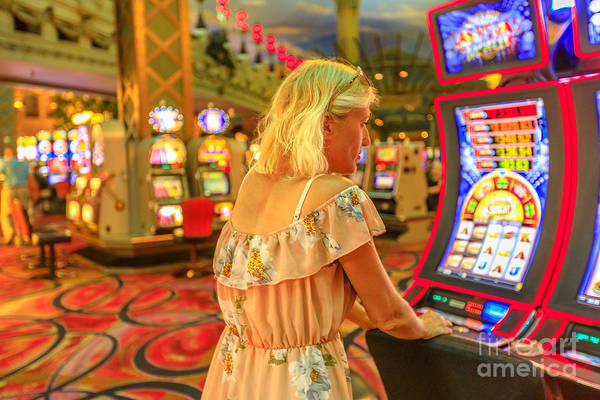 Photograph - Woman Plays Slot Machines by Benny Marty