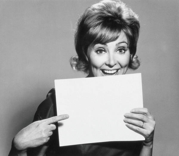Caucasian Photograph - Woman Pointing To A Blank Sheet Of Paper by Archive Holdings Inc.
