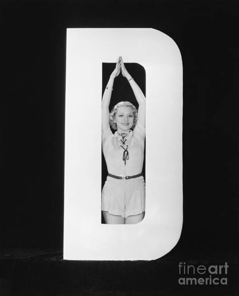 Wall Art - Photograph - Woman Posing In Middle Of Letter D by Everett Collection
