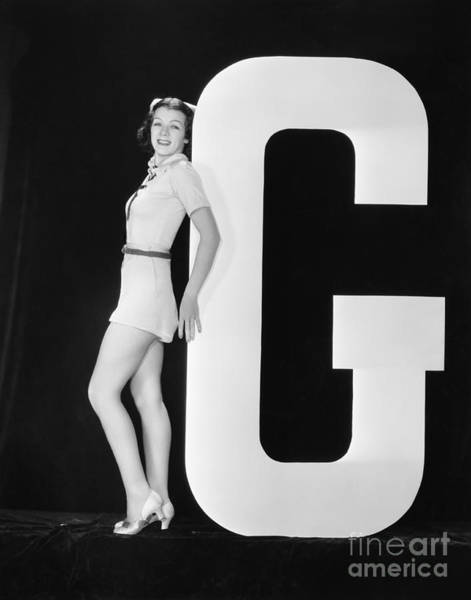 Wall Art - Photograph - Woman Posing With Huge Letter G by Everett Collection