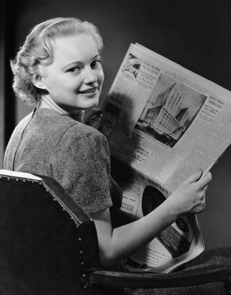Newspaper Photograph - Woman Reading Newspaper by George Marks
