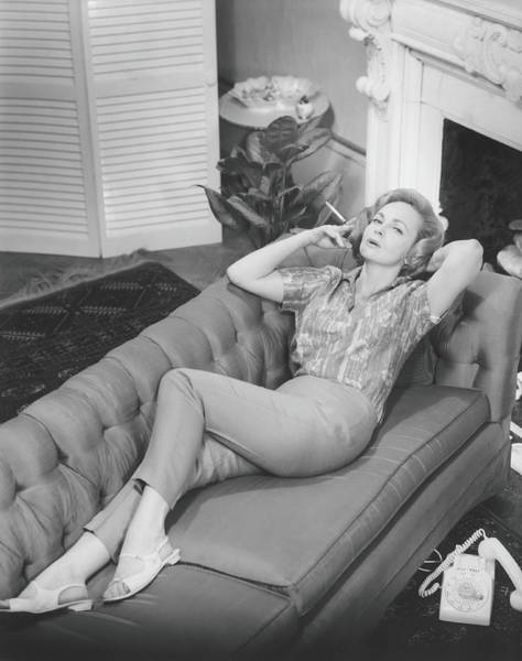 Wall Art - Photograph - Woman Relaxing On Sofa, B&w, Elevated by George Marks