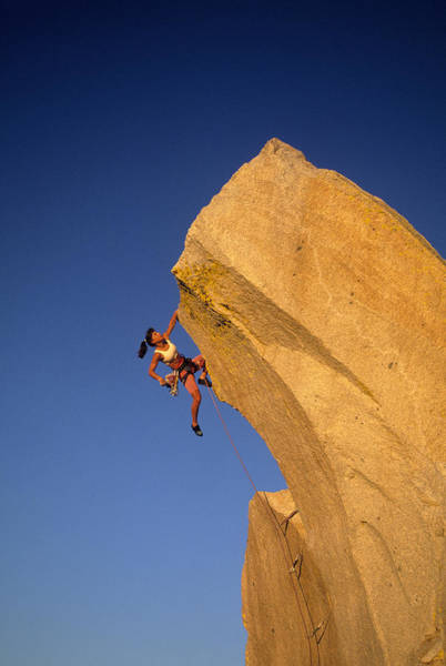 Climbing Photograph - Woman Rock Climber Climbing Cliff Wall by Greg Epperson