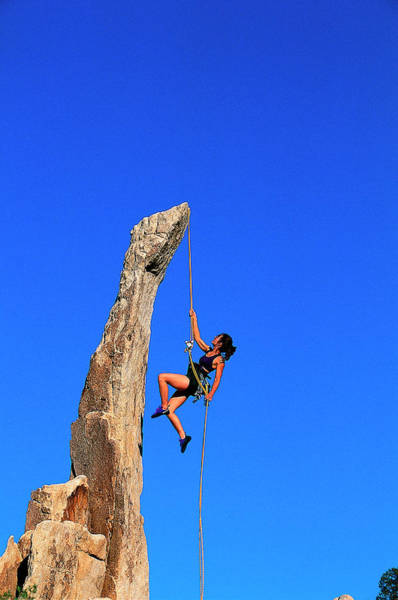 Hanging Rock Photograph - Woman Rock Climbing, Joshua Tree Np, Ca by Greg Epperson