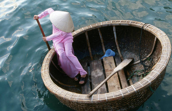 Headwear Photograph - Woman Rows Basket Boat On Vietnams by Stu Smucker