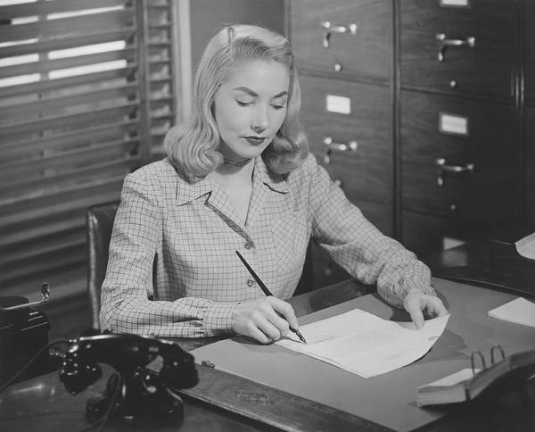 Businesswoman Photograph - Woman Sitting At Desk, Writing Letter by George Marks