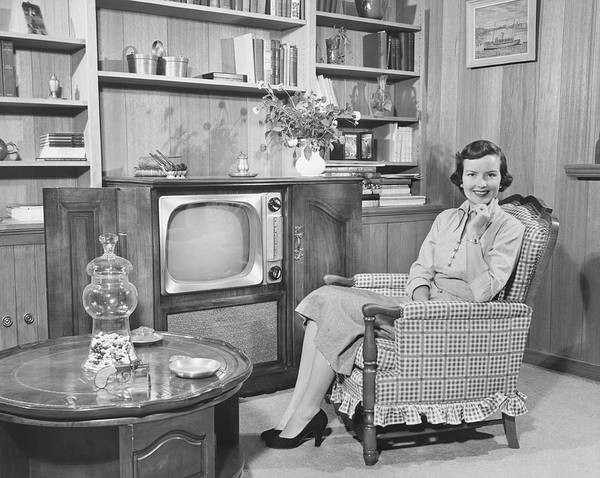 Armchair Photograph - Woman Sitting In Armchair In Living by George Marks