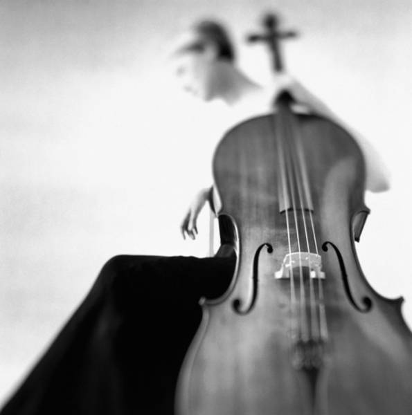 Caucasian Photograph - Woman Sitting In Gown Holding Cello by Getty Images