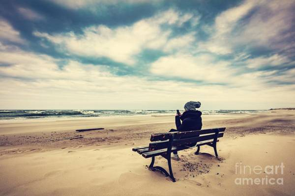 Wall Art - Photograph - Woman Sitting On A Bench On The Beach Using Her Phone by Michal Bednarek