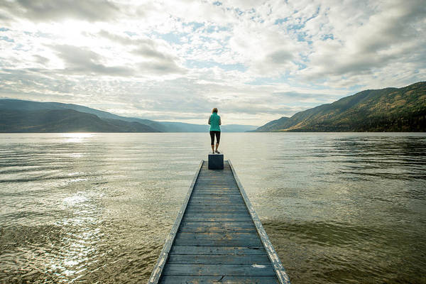 Woman Stand At End Of Pier Above Lake Art Print