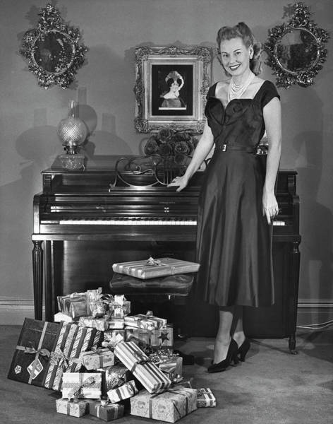 Piano Photograph - Woman Standing By Piano & Presents by George Marks