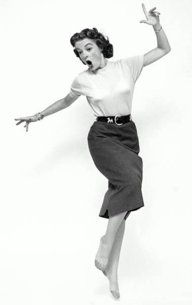Photograph - Woman Standing On One Leg by Alfred Gescheidt