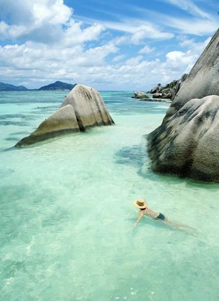 Sun Hat Photograph - Woman Swimming Close To Shore Beside by Chris Caldicott