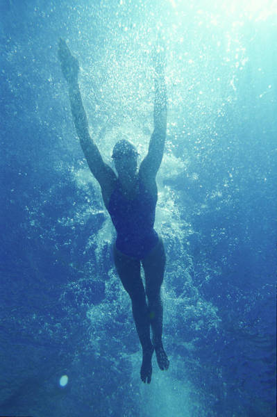 Underwater Photograph - Woman Swimming Underwater by Bellurget Jean Louis