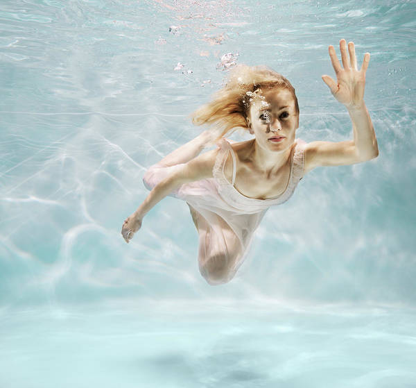 Underwater Photograph - Woman Swimming Underwater by Henrik Sorensen