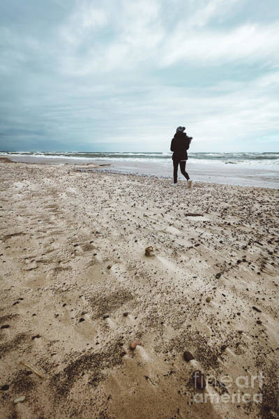 Wall Art - Photograph - Woman Walking Alone On The Beach On Windy Stormy Day. by Michal Bednarek