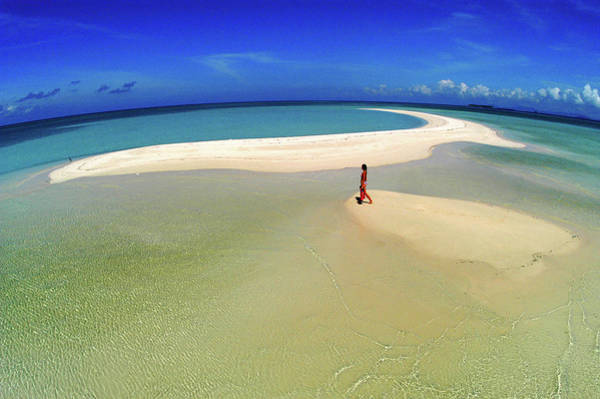 Fish Eye Lens Photograph - Woman Walking Along Sand Bar At A by Tim Rock
