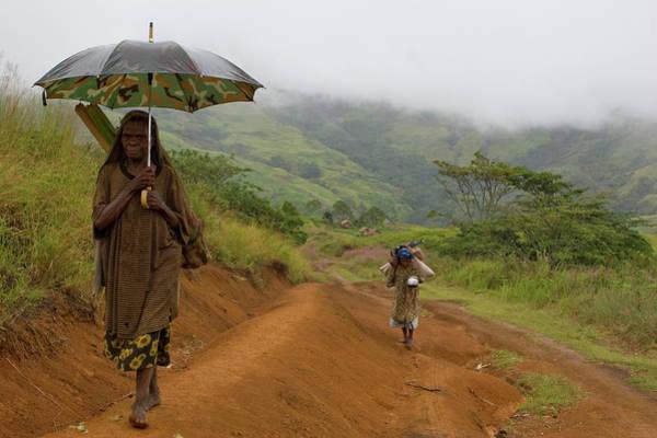 Woman Walking With Umbrella On Track Art Print