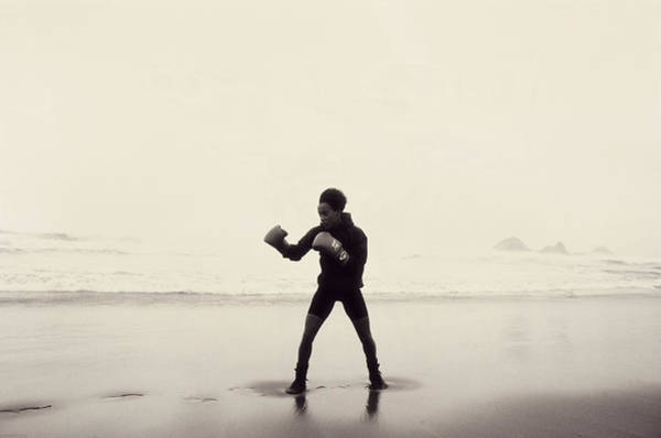 Boxing Photograph - Woman Wearing Boxing Gloves On Beach by Anne-marie Weber