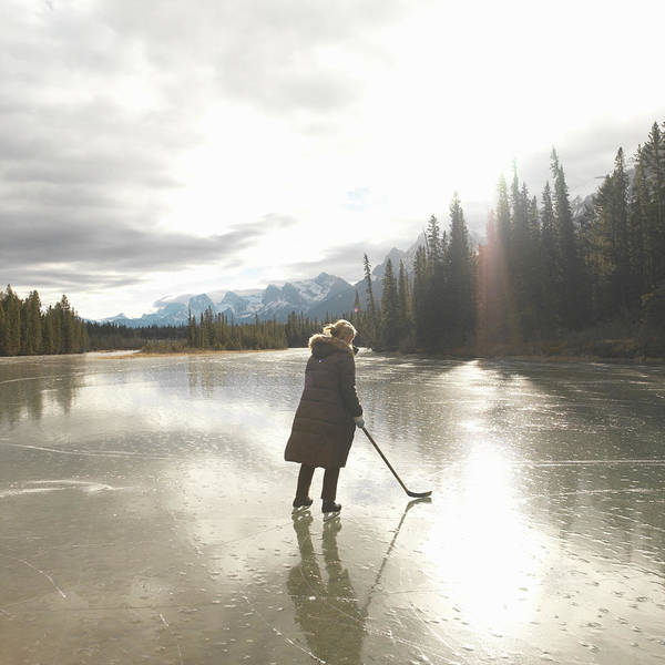 Wall Art - Photograph - Woman Wearing Ice Skates On Lake by Ascent/pks Media Inc.