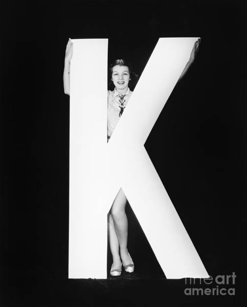 Wall Art - Photograph - Woman With Huge Letter K by Everett Collection