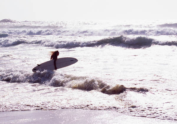 Wind Surfing Photograph - Woman With Surfboard In Sea by Johner Images