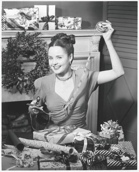 Paper Dress Photograph - Woman Wrapping Christmas Presents In by George Marks