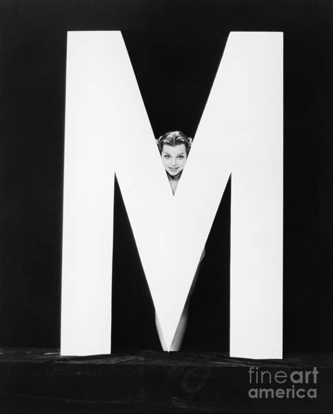 Wall Art - Photograph - Womans Face With Huge Letter M by Everett Collection