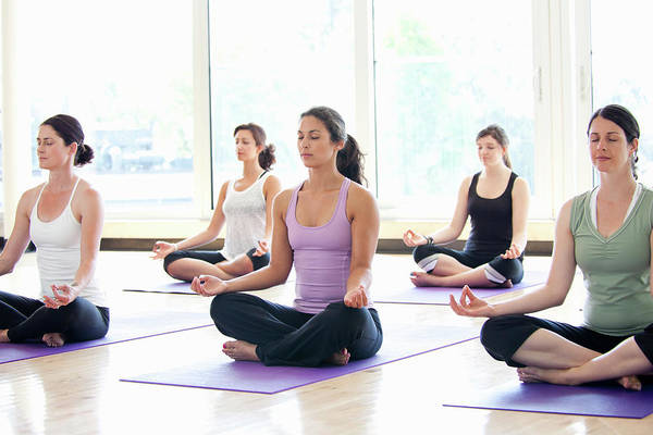 Practice Photograph - Women Practicing Yoga In A Class by Assembly