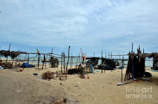 Photograph - Wood And Bamboo Palm Leaf Thatched Shacks By Seaside In Fishing Village Pattani Thailand  by Imran Ahmed