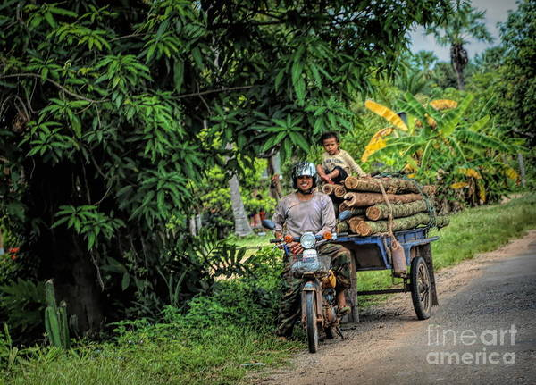 Wall Art - Photograph - Wood Transport Cambodian Man And Child  by Chuck Kuhn