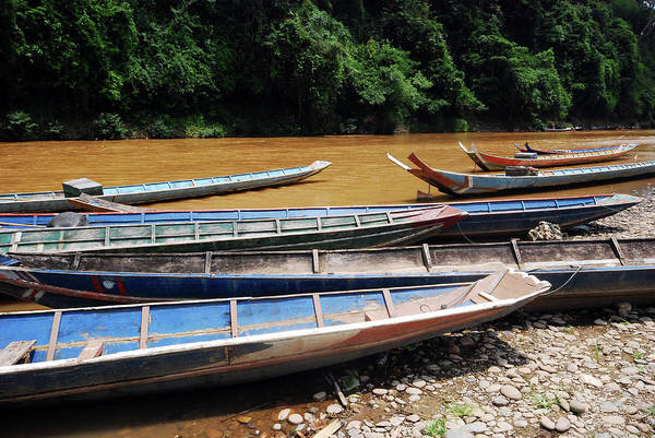 Southeast Asia Wall Art - Photograph - Wooden Boat On River In Laos by Thepurpledoor