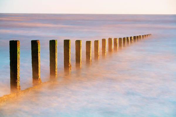 Wooden Groynes, Leysdown, Isle Of Art Print by John Miller Photographer