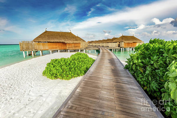 Wall Art - Photograph - Wooden Jetty And Cabins On Maldives. by Michal Bednarek